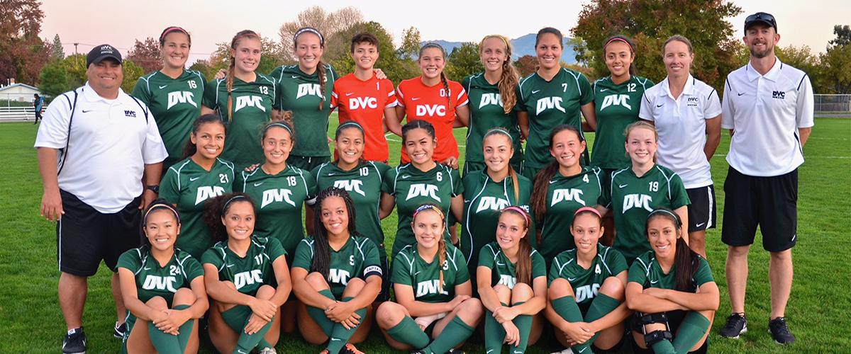 Photo of members and coaches of the DVC women's soccer team in uniforms.