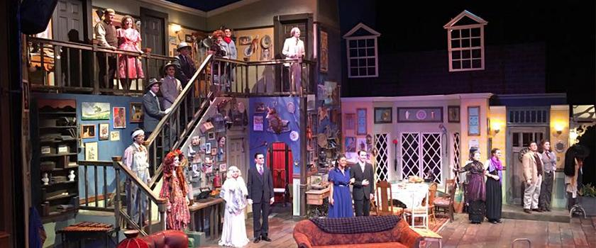 Photograph from the set of DVC's production of You Can't Take it With You, featuring the inside of a house, complete with a second floor.