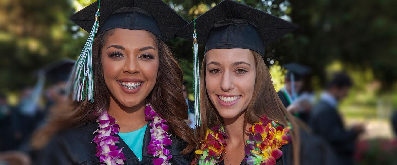 photo of two happy graduates.