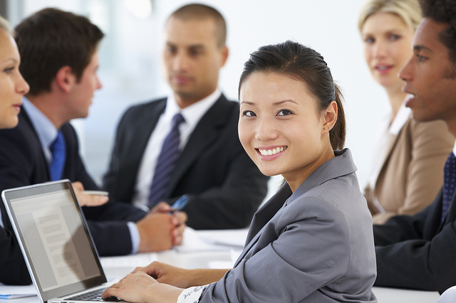 Business meeting with smiling woman facing forward