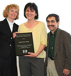Rachel Westlake, Dean of Math and Computer Science, left, and Despina Prapavessi, center, receive 2007 HP Technology for Teaching Higher Education Leadership Grant