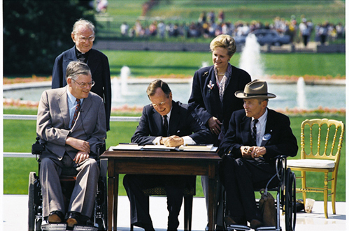 President Bush signing the ADA into law